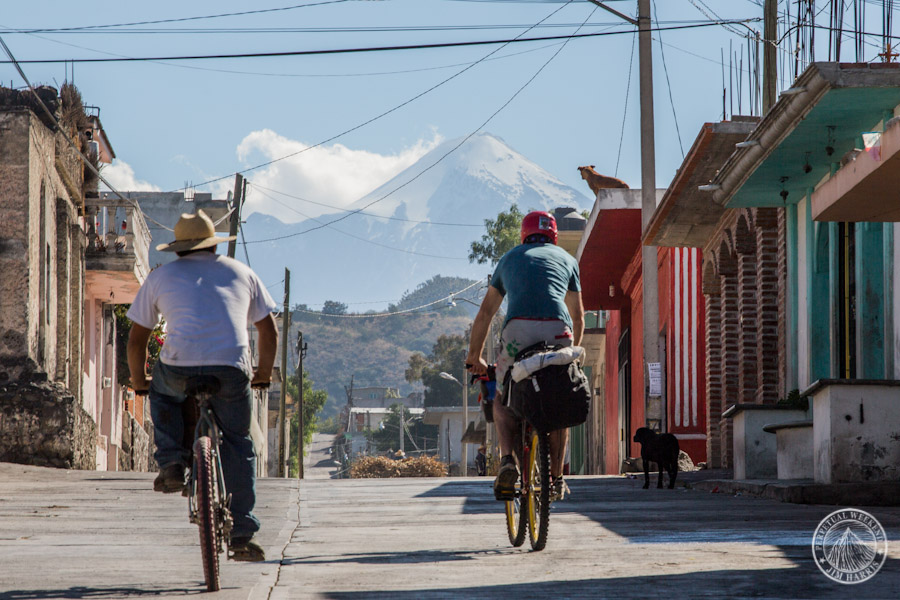Mehk, a local, and the hounds all look towards Orizaba in Aljojuca