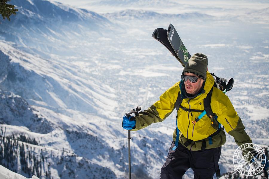 Forrest Shearer climbing Mt Olympus, Utah above smoggy Salt Lake City, Utah