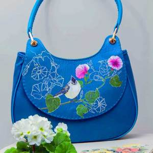 Panted leather handbag