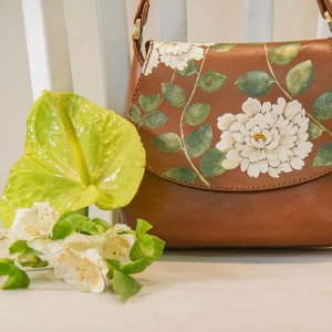 Painted hand stitched leather handbag