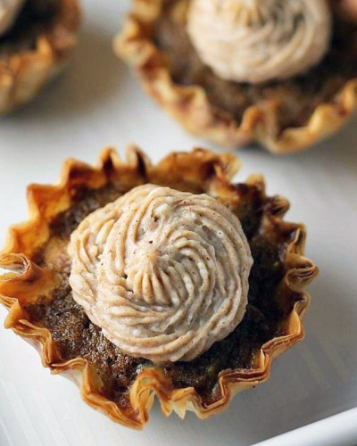 closeup of mini sweet potato pie with cinnamon cream cheese frosting
