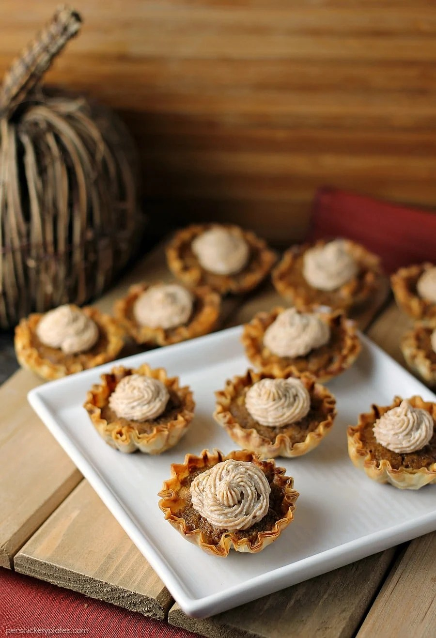 Mini Sweet Potato Pies with Cinnamon Cream Cheese Frosting are super easy to make but look fancy. Impress your guests with these bite sized treats!   www.persnicketyplates.com