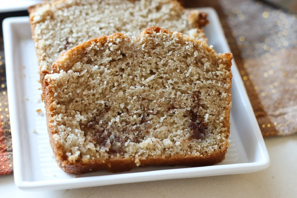 slice of cinnamon quick bread on white plate