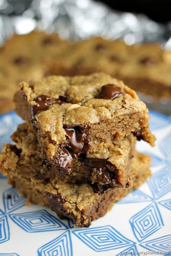 Peanut Butter Blondies filled with chocolate chips and peanut butter chips are soft and chewy and begging to be topped with vanilla ice cream! | Persnickety Plates