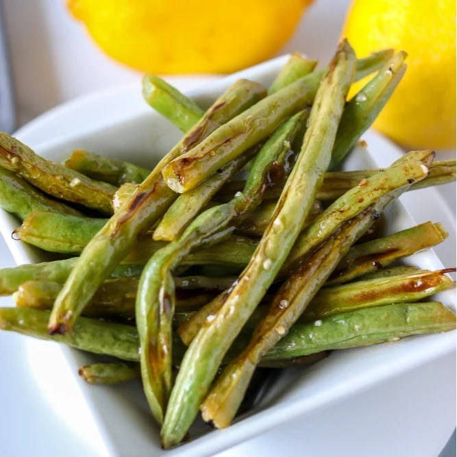 white bowl of oven roasted garlic green beans