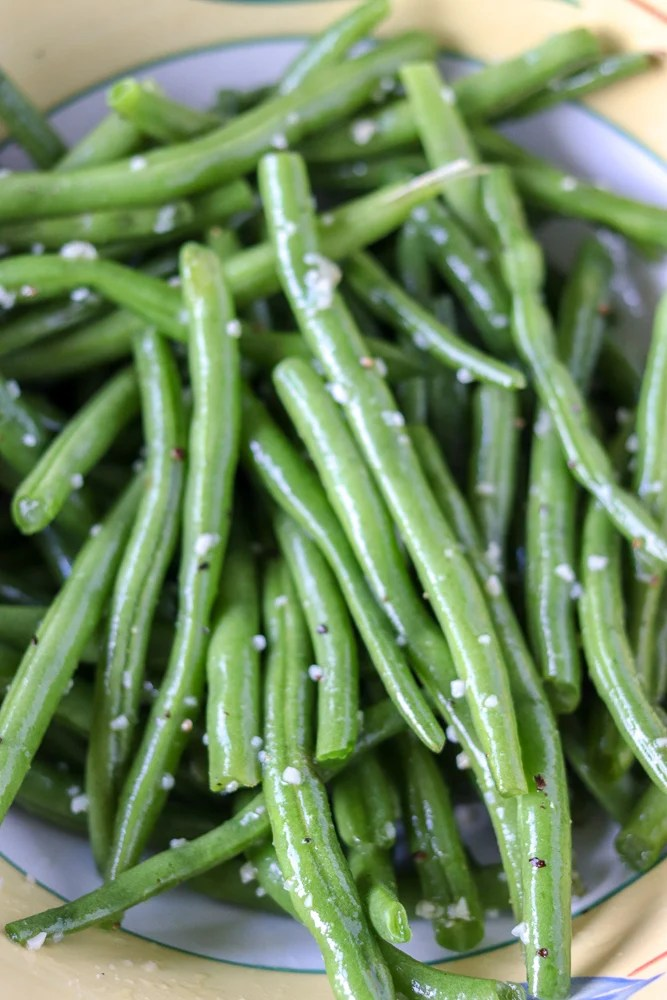 garlic green beans prepped in a bowl with garlic