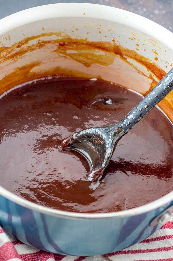 pot of copycat kfc honey bbq sauce with spoon