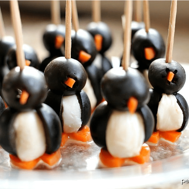 penguins made out of black olives, mozzarella balls, and carrot feet. Held together with toothpicks.