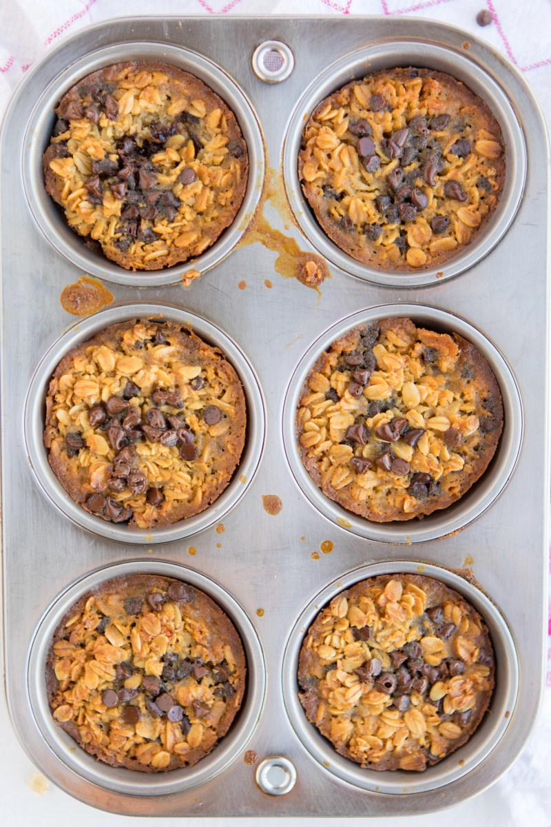 muffin pan of 6 Baked Oatmeal Breakfast Cups sprinkled with mini chocolate chips fresh from the oven