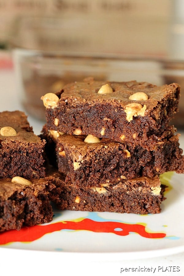 Peanut Butter Brownies are a simple, from scratch, brownie filled with chunky peanut butter and topped with peanut butter chips. Perfect for the chocolate + peanut butter lover in your life!   Persnickety Plates