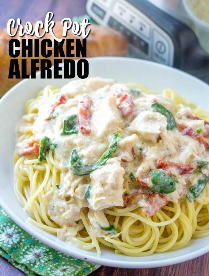 large white bowl of crock pot chicken alfredo pasta