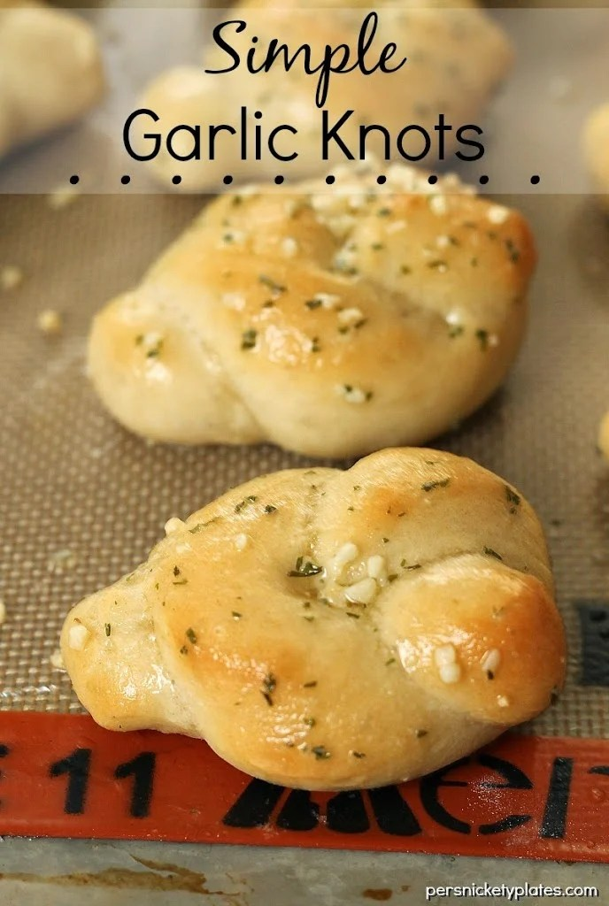 These Simple Garlic Knots are a delicious side dish to a Sunday dinner. Perfect for large gatherings or a quick late night snack, these buttery rolls will disappear quickly!