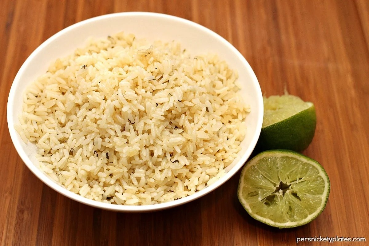 Making cilantro lime rice at home is nearly as easy as ordering it at your favorite Mexican restaurant!   Persnickety Plates