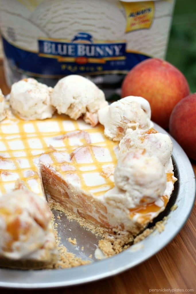 Super simple Peaches and Cream Ice Cream Pie is made with broiled peaches and creamy vanilla bean ice cream. The perfect dessert for a hot summer day! | Persnickety Plates #SunsOutSpoonsOut #ad