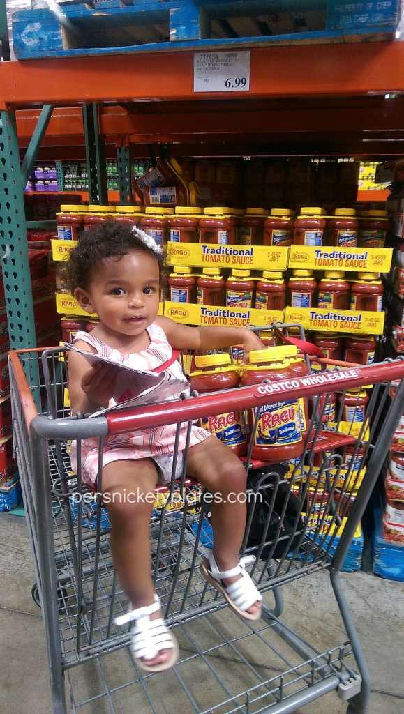 girl in costco shopping cart buying ragu sauce
