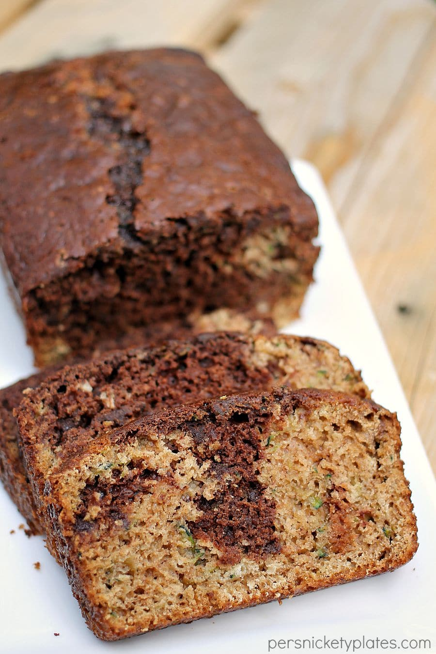 chocolate marble zucchini bread sliced on a white platter