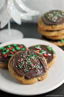 A brown butter chocolate chip cookie slathered with a layer of salted caramel then topped with chocolate and sprinkles.   Persnickety Plates