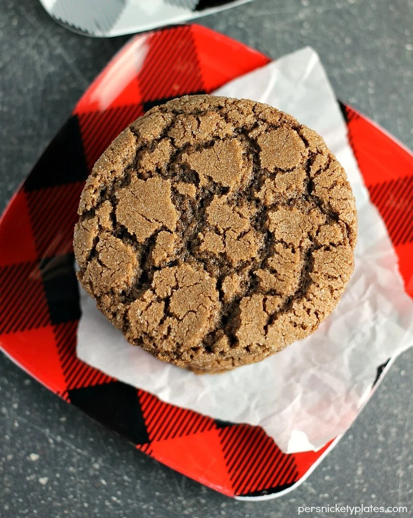 overhead shot of chocolate cookie on buffalo plaid red plate