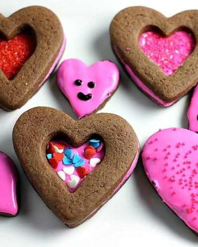 Simple chocolate roll-out cookies frosted and sprinkled for Valentine's Day!   Persnickety Plates