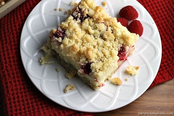 Raspberry Cream Cheese Crumb Cake is layered with a creamy cheesecake , fresh raspberries, and topped with a cruchy streusel topping. Perfect for brunch or dessert!   Persnickety Plates