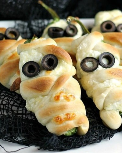 """Jalapeno Popper Mummies wrapped in Rhodes bread """"bandages"""" make a spicy and spooky treat for your next Halloween party! 