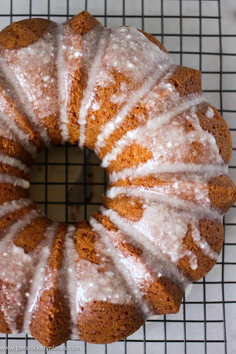butterscotch bundt cake with powdered sugar glaze on a cooling rack