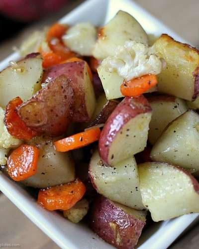 Garlic Roasted Veggies are a mix of cauliflower, carrots, and red skin potatoes tossed in olive oil and garlic and roasted to perfection.   www.persnicketyplates.com