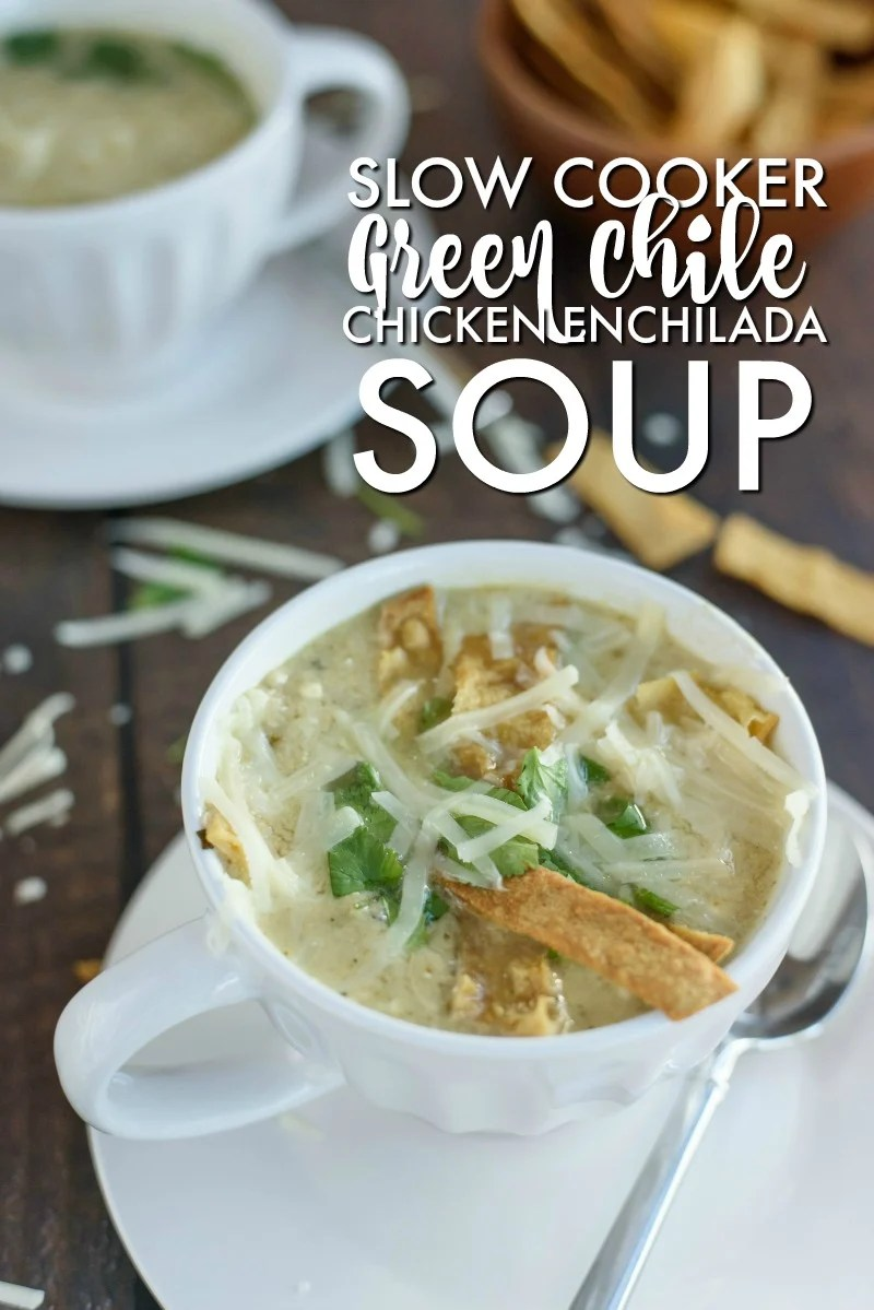 bowl of chicken enchilada soup topped with cheese, tortilla strips, and cilantro