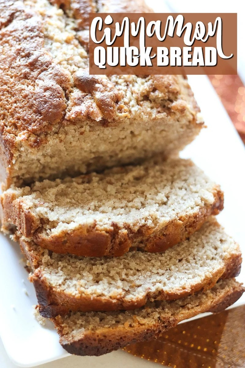 sliced loaf of cinnamon quick bread on white plate