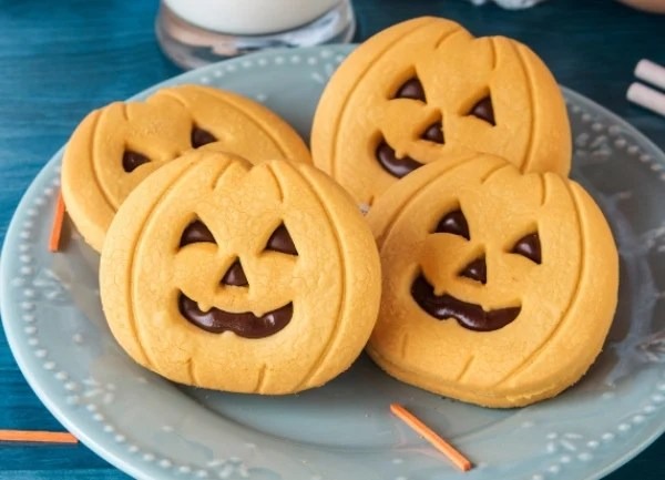 friendly, happy orange jack-o-lantern sugar cookies