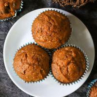 three pumpkin muffins on a white plate