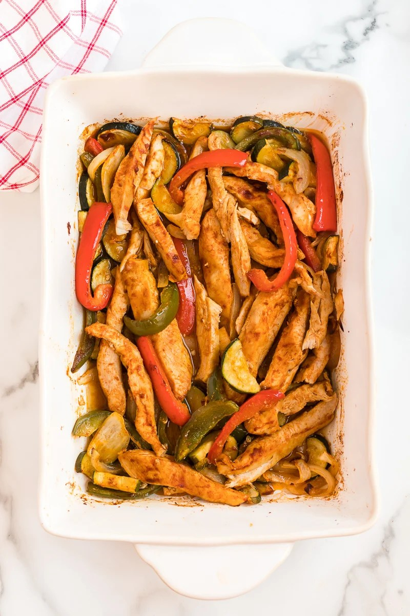 baked chicken fajitas in a white baking dish