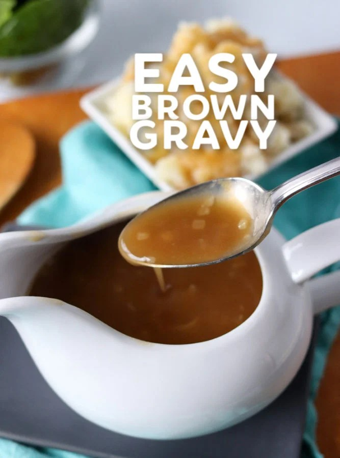 gravy on a spoon over a gravy boat