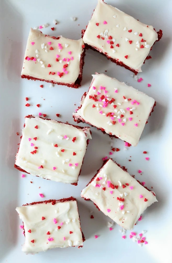 white plate of cookie bars topped with valentine sprinkles