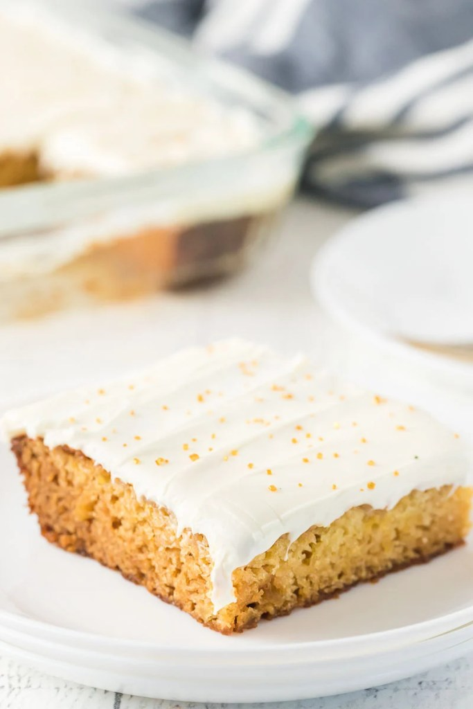slice of cake with dripping cream cheese frosting