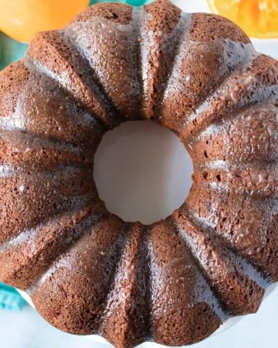 overhead shot of glazed orange banana bundt cake