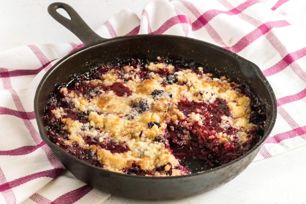 blackberry crumble in a cast iron skillet