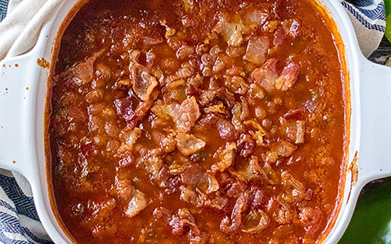 overhead shot of baked beans with bacon