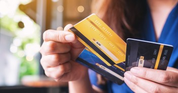 Women holding credit and debit cards