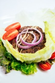 An easy cheeseburger salad with lettuce, tomatoes, onions, and your favorite fixings!