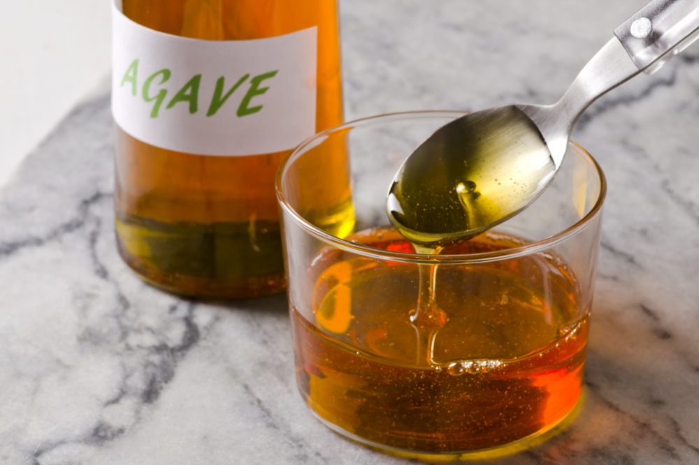 Agave syrup poured in a bowl ready poison your liver.