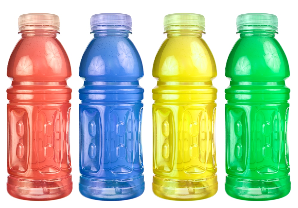 Four colorful and expensive bottles of sugary sports drinks.