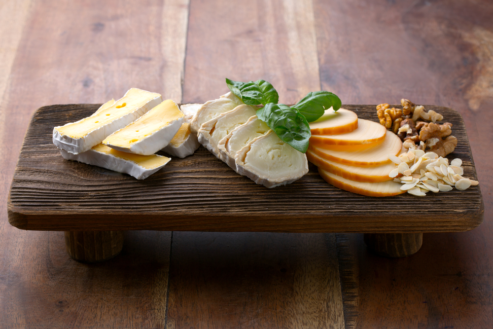 A cheese flight is perfect while dining out with Personal Trainer Food.