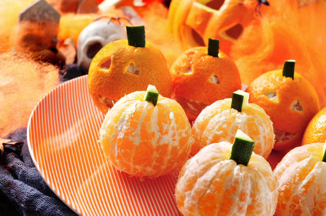 Peel some tangerines and stick a little zucchini stem in the top for a festive and healthy Halloween treat.