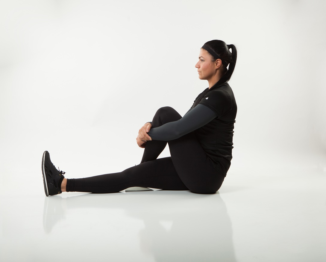 This seated glute stretch from Personal Trainer Food can help reduce hip pain and sciatica.