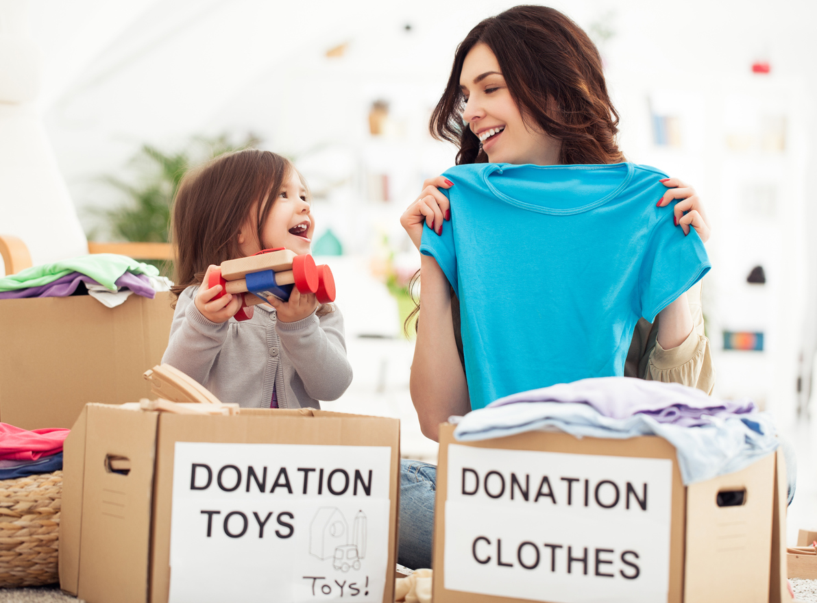 Mother and daughter preparing toys and clothes to donate for charity using their PTF box and the Givebackbox program.