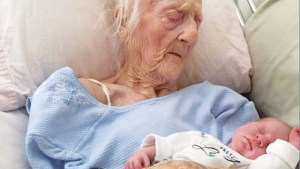 Old Woman Holding Baby