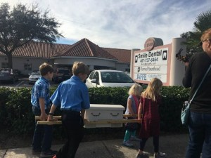 Children Carrying a Casket Outside of Planned Parenthood