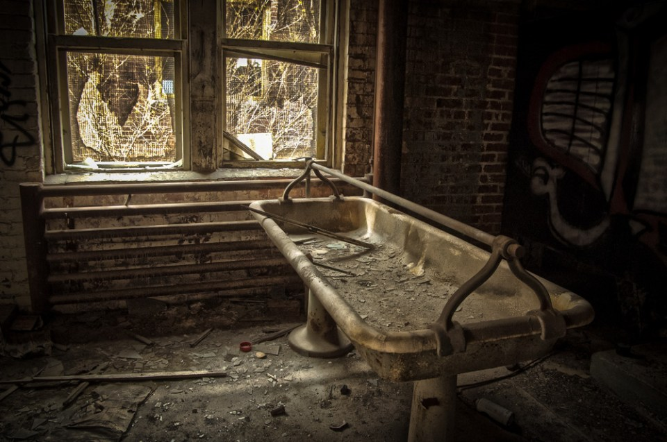 Washroom - A huge wash basin in the restrooms of an abandoned sugar mill