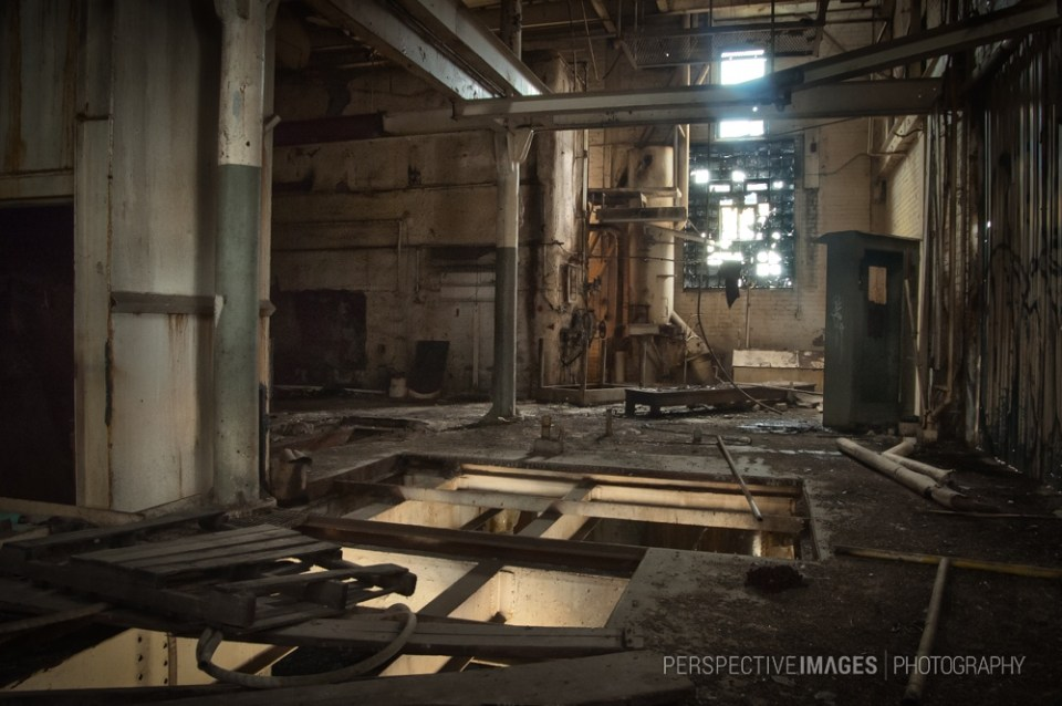 The Fire Below - Salvaged machinery has left gapping holes in the floor creating dramatic lighting.